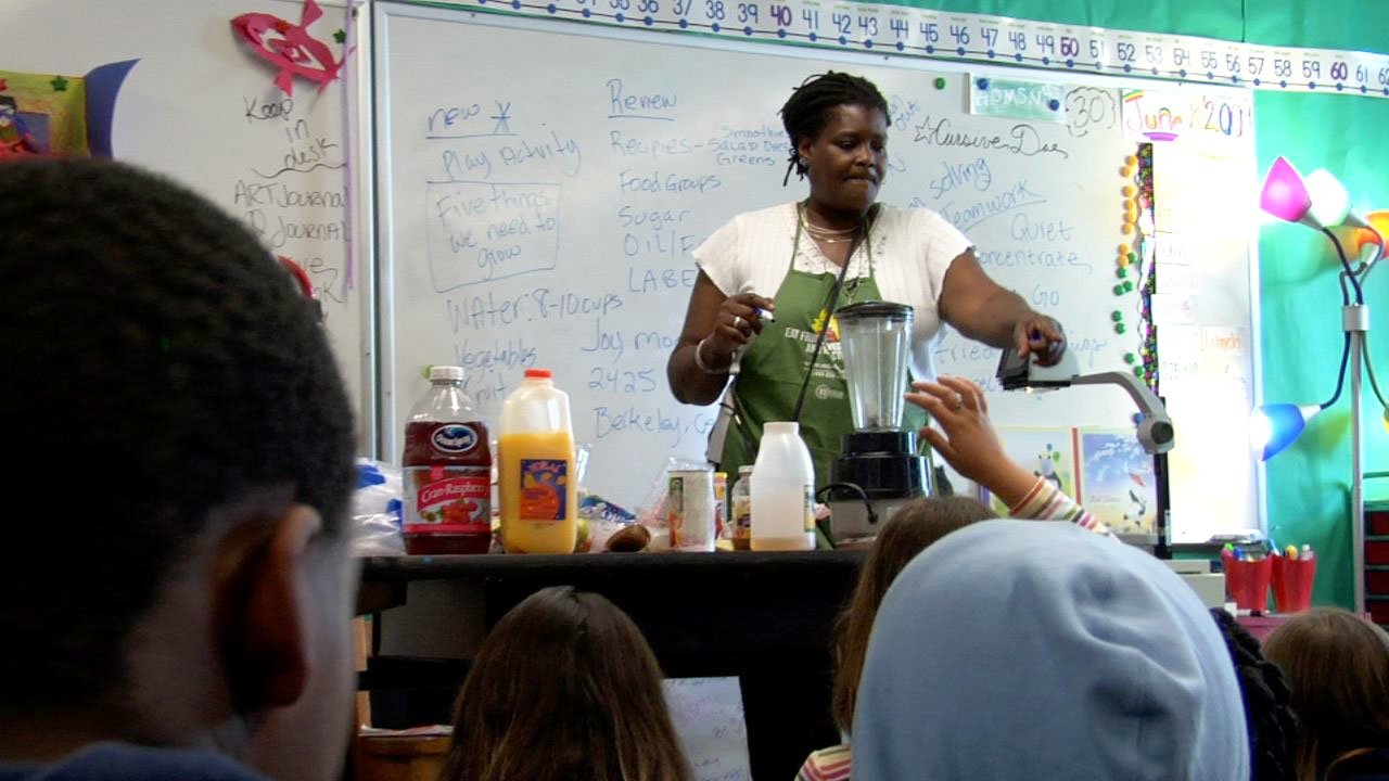 Joy Moore teaches elementary school kids about nutrition, as featured in Lunch Love Community./Photo: Sophie Constantinou