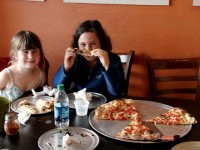 Young customers enjoy the pizza at Emilia's Pizzeria, which came in fourth in the reader rankings