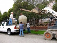 One of the new urns is unloaded prior to being placed in at its new site. Photo:  Suzanne Riess
