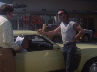 Junkie CIty Life (Billy Gray) negotiates the purchase of a car stereo in Dusty and Sweets McGee