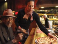 Giovanni's daughter, Anastasia serving long time regular, Julio Jefferson. Photo: Giovanni