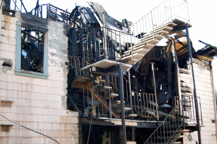 The rear of the apartment building at 2227 Dwight Way where extensive fire damage is evident. Photos: Tracey Taylor