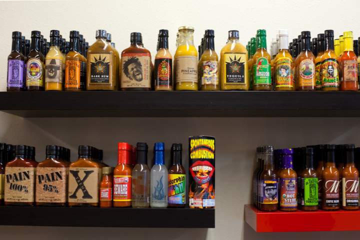 Some of the hottest sauces in the store sport warning labels. Photo: Emilie Raguso