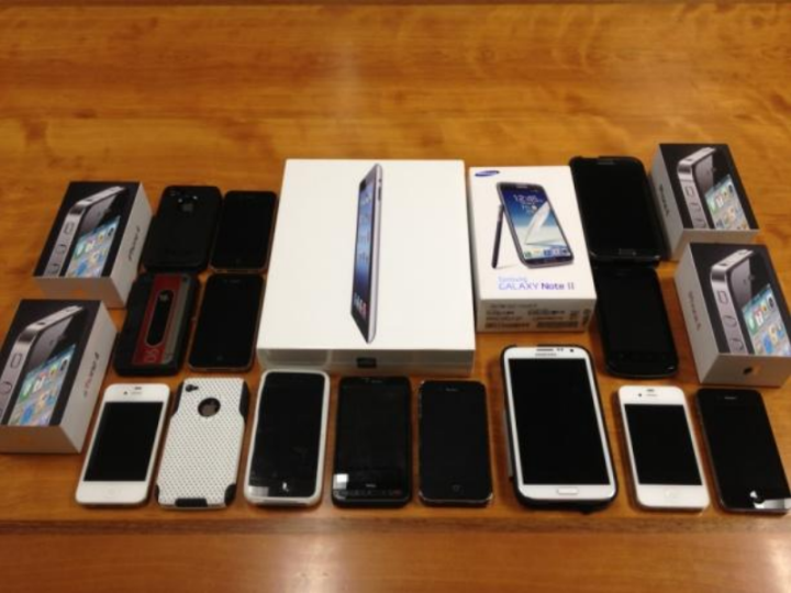 Police seized over 20 cell phones, some of which were stolen, during an investigation that led to the arrest of a local store clerk. Photo: Berkeley Police Department