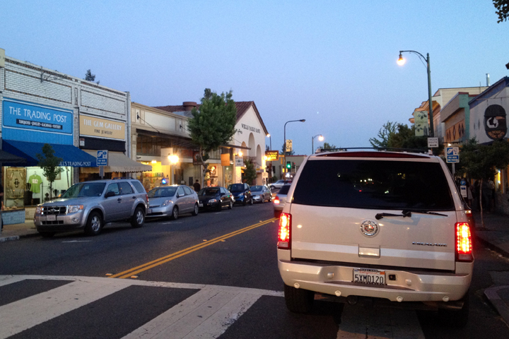 A driver unable to find a spot in The Elmwood neighborhood parks instead in the crosswalk. Photo: Emilie Raguso