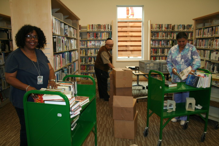 Raylene Ezike, a library specialist, Jeri Ewart, the branch manager, and Uma Paul, a supervising library assistant, put books away on Tuesday in preparation of the South Branch opening. Photo: Frances Dinkelspiel