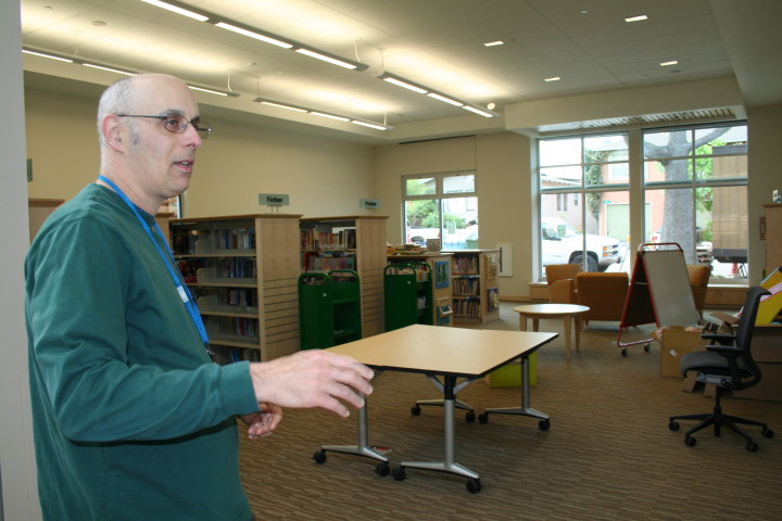 Children's librarian Josh Lachman stands in front of the new children's room. Photo: Frances Dinkelspiel