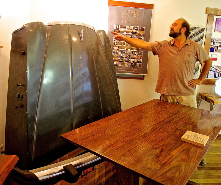 Joshua Goldberg, of Joshua Tree Custom Furniture and Cabinets, shows off a car hood that is part of a fold out bed. Photo: Ted Friedman