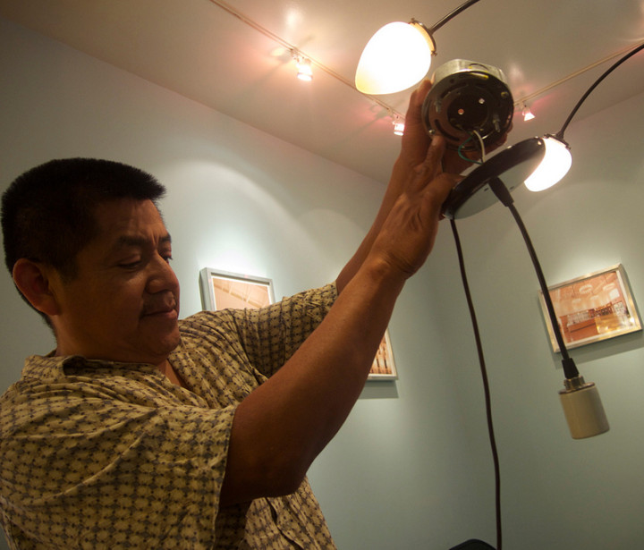 Francesco Munoz, of Munoz Electrical Service demonstrates,installing a light at Metro Lighting/ Photo: Ted Friedman.