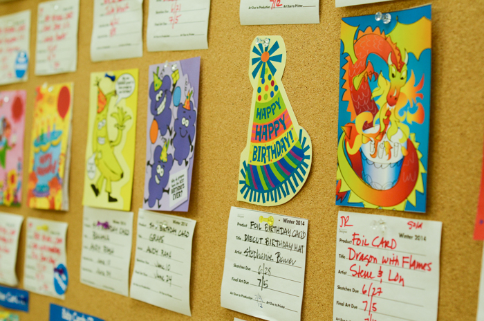 Work in progress birthday cards dot the walls of children's game, sticker, and card manufacturer Peaceable Kingdom's Berkeley offices.