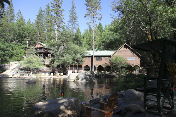 The Berkeley-run Tuolumne Family Camp in more halcyon times. The Dining Hall is on the right.  On the left, high on the rock is the recreation center, which also burned. Photo: Sonny Abesamis/Creative Commons.
