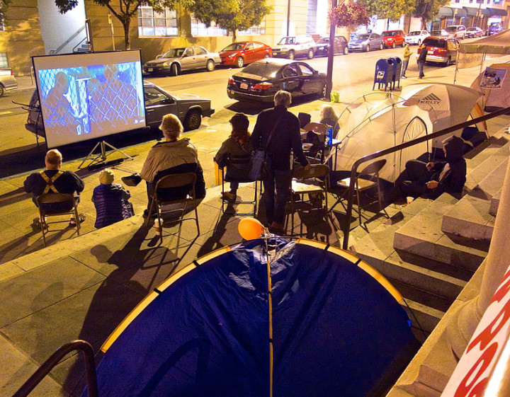 Friday night was movie night for the protestors camped out at the Main Post Office at 2000 Allston Way. Photo: Ted Friedman