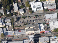 City officials are considering the possibility of turning this parking lot into a supportive homeless housing complex. Image: Google Maps