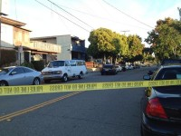 Police taped off the street while they investigate a shooting in West Berkeley on Sunday. Photo: Emilie Ragus0