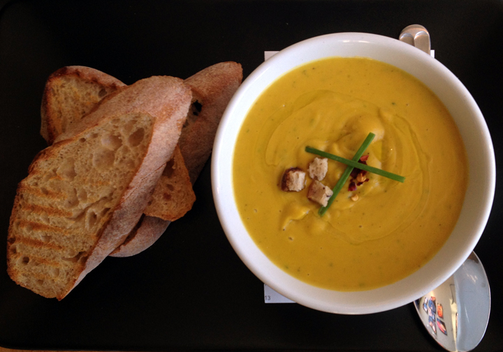 The seasonal soup is vegetarian and made with kabocha squash, coconut cream, chili and chive, and served with levain toast ($5.25).