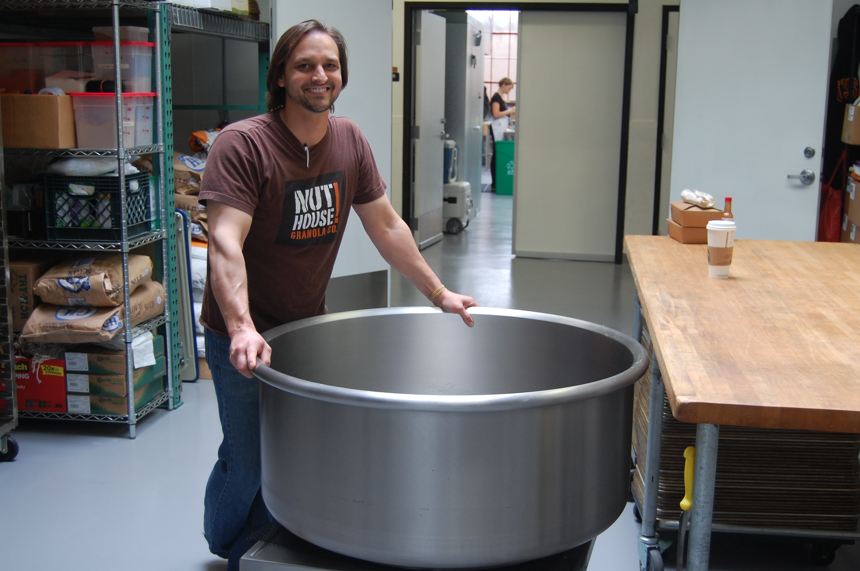 Craig Boon with the giant mixing bowl he uses to make his Nuthouse Granola.