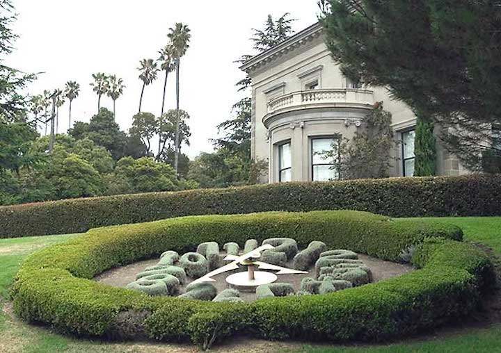 Topiary sundial at University House.  Photo: National Register.
