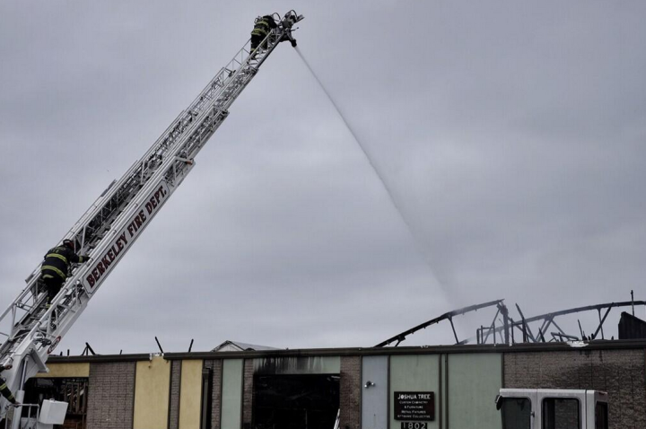 Firefighters continued to dose the building with water on Sunday morning. Photo: Pete Rosos