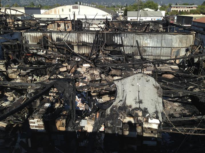 The remains of the warehouse of the Wooden Duck furniture store which was destroyed in a five-alarm fire on Saturday April 12, 2014. Photo: Todd Forbush