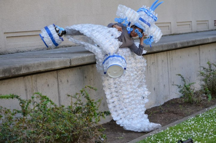 """""""Clothed"""" in plastic water bottles, NAKA Dance theater founder Jose Navarette rolls off the ledge of a building in downtown Berkeley to represent the risks we face from polluted water. Photo: James Corr"""