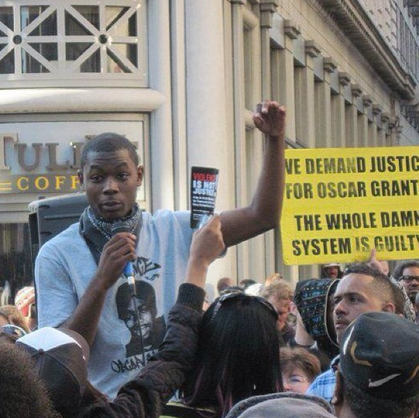 Jevon Cochran, speaking out about during a rally in 2010 regarding the killing of Oscar Grant. Image: Jevon Cochran/Instagram