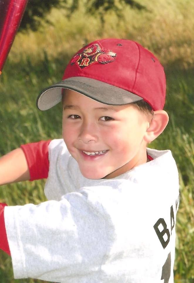 Baylor Fredrickson, seen here when he was six and playing Little League, needs to find a bone marrow donor in the next three months in order to survive. Photo: courtesy Fredrickson family