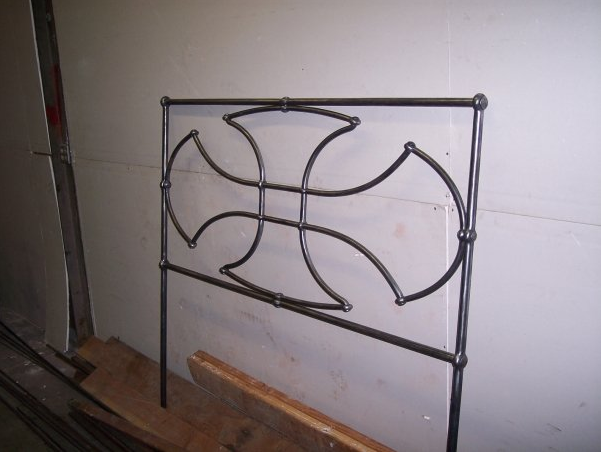 Iron headboard by Corey Nesbitt, The Hearth Forge