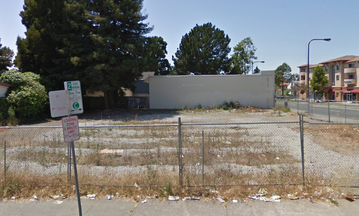 This vacant lot at University and McGee avenues is slated for development by Realtex Apartments. Image: Google Maps