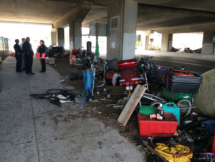 Police officers visit the homeless camp on Gilman Street in West Berkeley daily to provide outreach for residents. Photo: Drew Jaffe