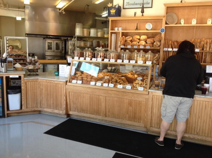 A customer selects pastries at La Farine on Monday, June 30. The bakery abruptly shut its doors Photo: Frances Dinkelspiel