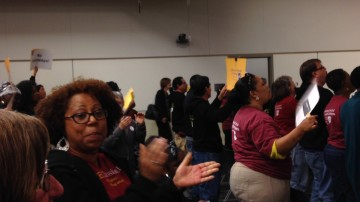 Paula Phillips, President of the Berkeley Council of Classified Employees, led union members in chanting at a June school board meeting.