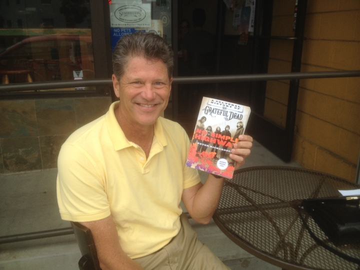 """Peter Richardson shows off an advanced copy of his book """"No Simple Highway: A Cultural History of the Grateful Dead."""" He's teaching a course with the same name beginning Oct. 1. Photo: Natalie Orenstein"""