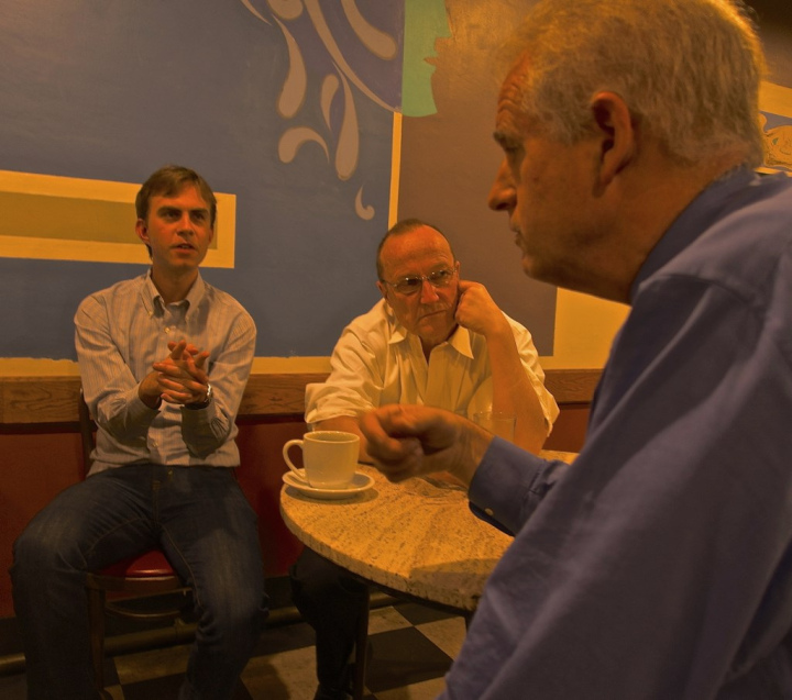 Sean Barry and Kriss Worthington talking to potential voters at Cafe Med. Photo: Ted Friedman