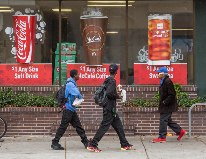 Two high-school students on their lunch break carry food and drink out of the McDonald's on University Avenue in Berkeley. Photo, taken on Monday Oct. 20, 2014, by Gael McKeon