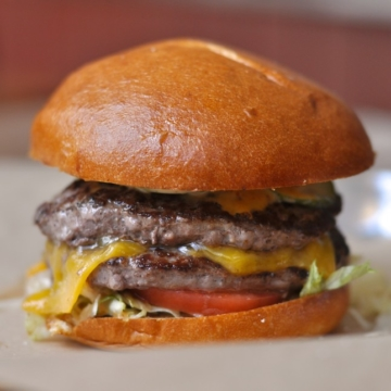 Some Yelpers agree with us: this is a burger worth the trip to Fruitvale for. Photo: Alix Wall
