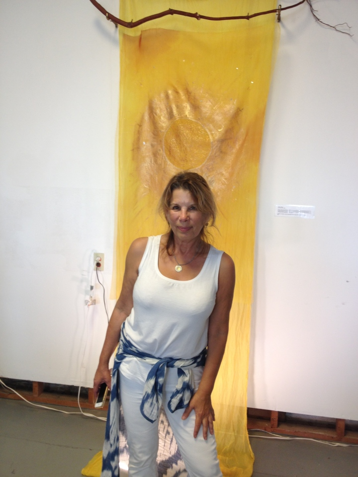 Artist Catherine Stern stands in front of her piece in the show 505Light. Photo: Frances Dinkelspiel