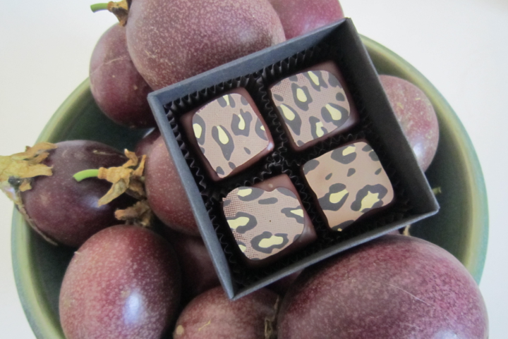 These leopard-spotted chocolates with passion fruit ganache are made from the author's passion fruit. Photo: Alix Wall