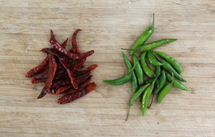 While many curry paste recipes call for a mix of many different dried peppers like long chiles and bird's eye chiles, I typically stick with what is readily available: dried red Thai chiles or chiles arbol. For my green curry, I use the fresh version while they are still green. Photo: Kate Williams