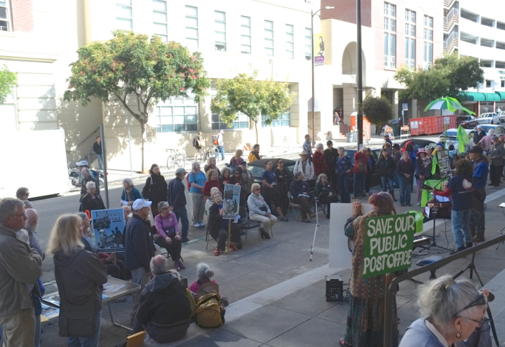 Demonstrators gathered outside the main Berkeley post office on Nov. 1 protesting its sale. Photo: Ted Friedman
