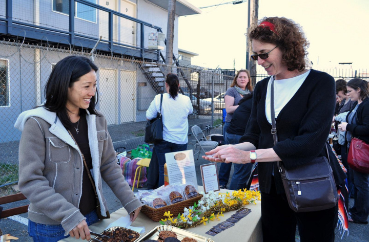 Clarine Lim Hardesty sells Clarine's Florentines at an early underground market