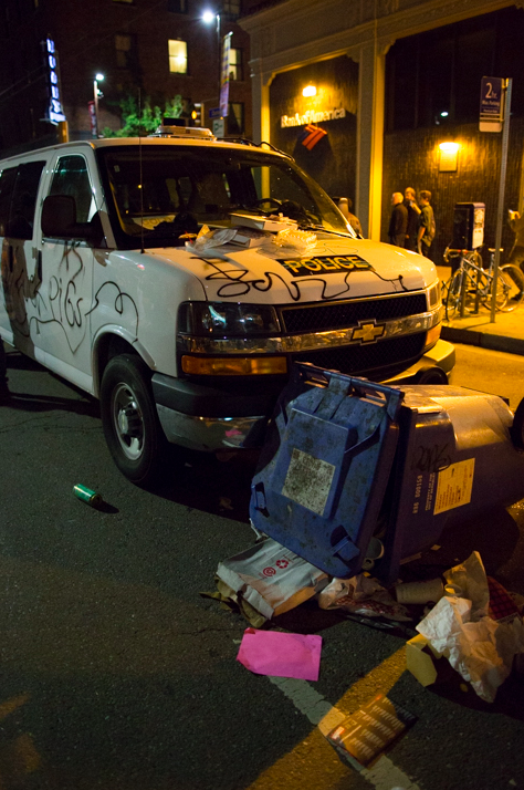 Several vehicles being used by the police were vandalized. Other vandalism included overturning trash cans and smashing windows at local businesses. Photo: Gael McKeon
