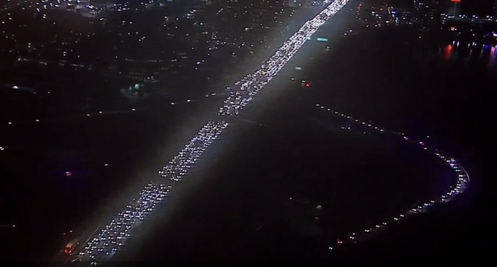 A line of police and CHP cruisers drive the onramp to get onto I-80 at around 9:15 p.m. on Monday Dec. 8. The freeway has been taken over by protesters. Photo: ABC7 live feed