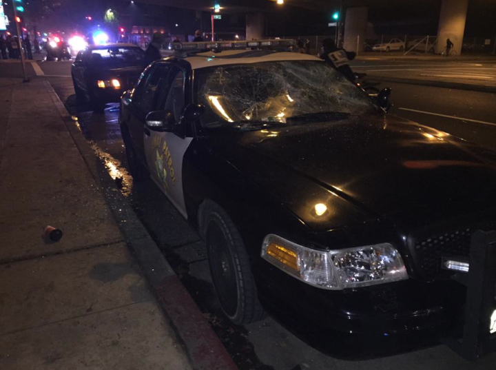 At around 10:10pm a police cruiser was vandalized. Photo: Emilie Raguso