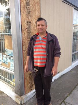 Tat Kwong stands outside the window that was smashed Sunday night at his store True Value Eastern Supplies. Photo: Frances Dinkelspiel
