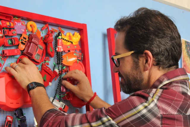 Sean Keller, fourth-grade teacher at Jefferson School, fixing one of the eco-art panels.