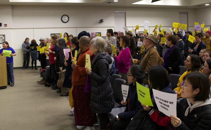 Students and faculty from Berkeley Adult School stand and hold signs in solidarity against relocation of the school on Thursday's board meeting. Photo: Seung Y. Lee
