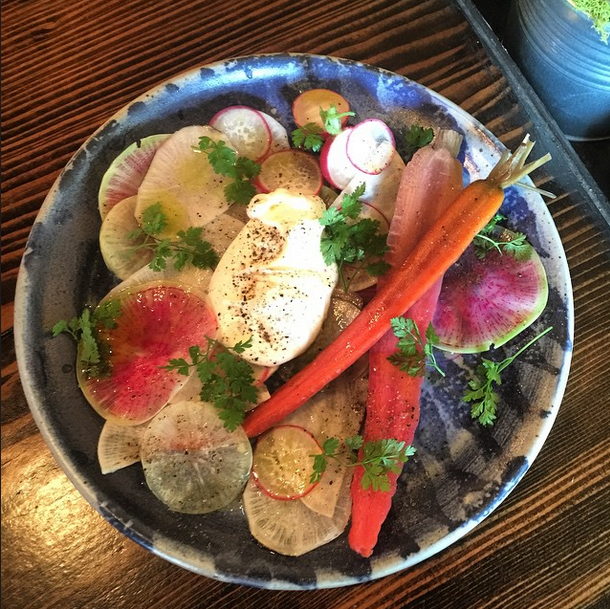 Winter radishes from river dog farms, house made creme fraiche, black pepper and San guilliano extra virgin organic olive oil, pickled rainbow carrots at Tigerlily. Photo: Tigerlily