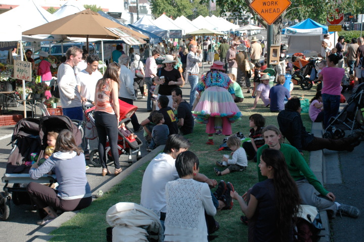 People sit on the grassy area next to Berkeley's Thursday Farmers Market in its current location. Photo: courtesy Ecology Center