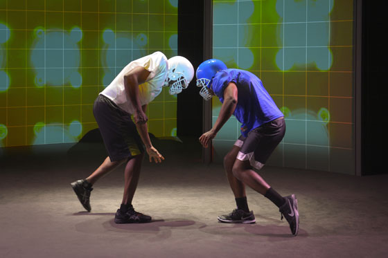 (l to r) Anthony Holiday (Addicott) and Eddie Ray Jackson (Anthony) perform in the world premiere of X's and O's (A Football Love Story), a hard-hitting docudrama at Berkeley Rep that examines our country's passion for a game that is life-giving yet lethal. Photo courtesy of kevinberne.com