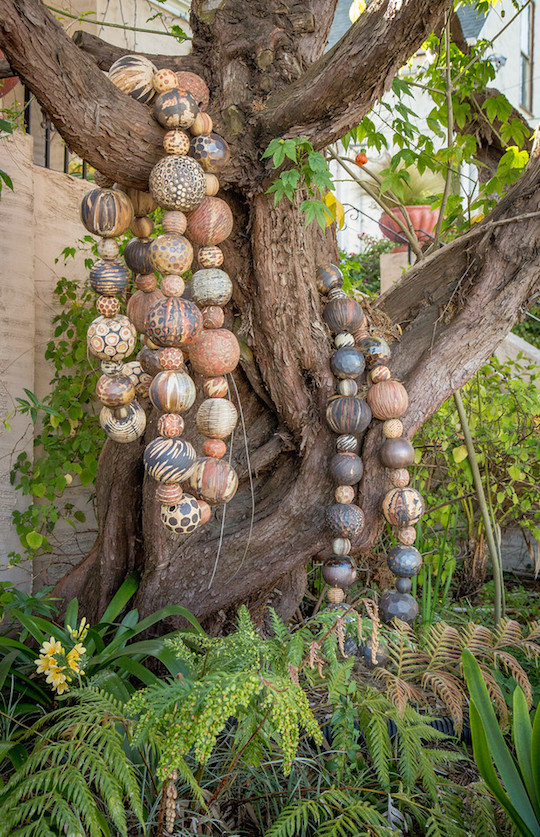 Ceramic mala in Marcia Donahue's garden. Photo: John Storey.
